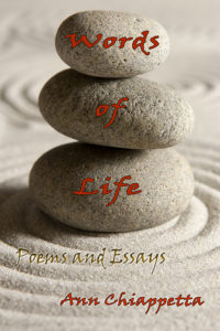A harmonious design of Three gray  oval shaped rocks stacked one upon the other beside  a pattern in the sand. Each  rock holds  one   word of the book's title.
